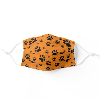 Fun Scattered Black Paw Prints on Orange Adult Cloth Face Mask