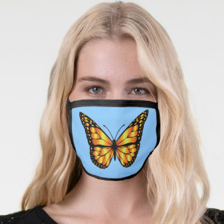 Golden yellow and black butterfly on light blue face mask