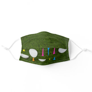 Golf ball with colorful tee on green grass adult cloth face mask