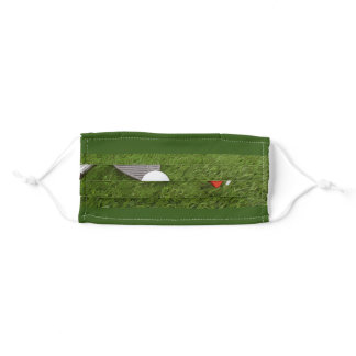 Golf ball with tee on green grass Cloth Face Mask