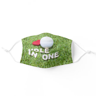 Golf hole in one with golf ball on green grass adult cloth face mask