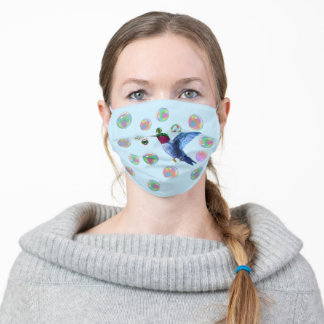 Hummingbird and soap bubbles on light blue adult cloth face mask