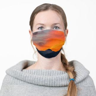 Stunning vibrant sunset behind mountain adult cloth face mask