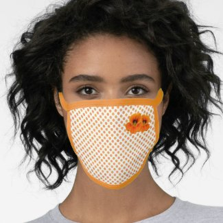 Orange face mask with dots and flower made from cotton